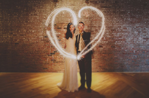 couple--with-Wedding-Sparklers-heart-shape