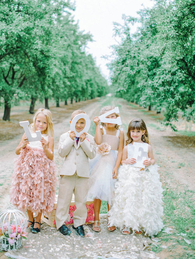 flower-girl-and-page-boys-with-love-sign
