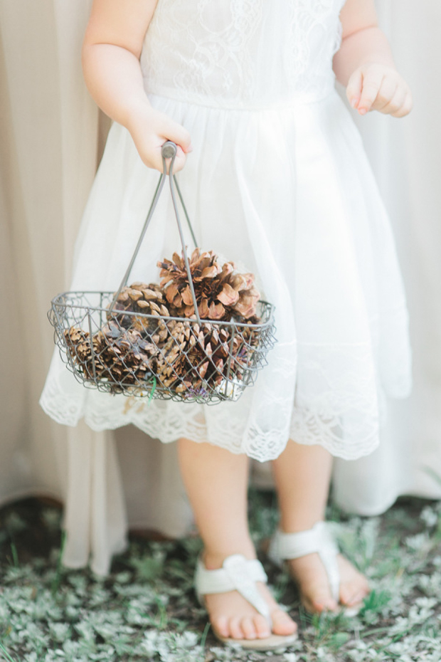 flower-girl-with-basket-of-pine-cones