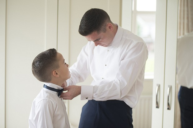 groom-fixing-page-boy's-bow-tie