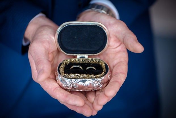 groom-holding-rings-ring-box