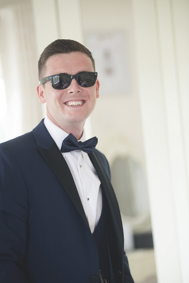 groom-in-black-tie-with-sunglasses
