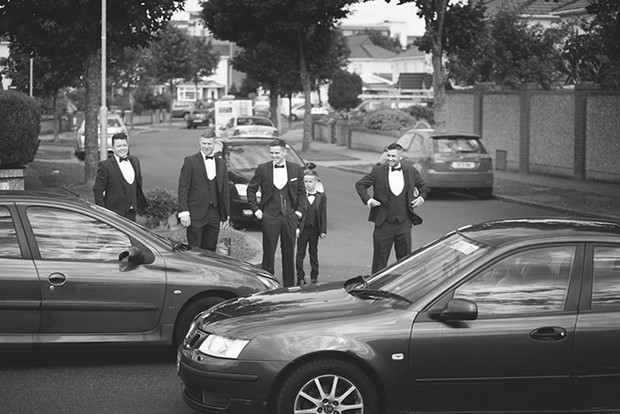 grooom-and-groomsmen-outside-ceremony