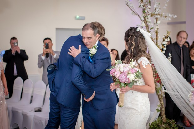 loughrea-hotel-real-wedding-paul-duane-father-of-the-bride-hugging-groom