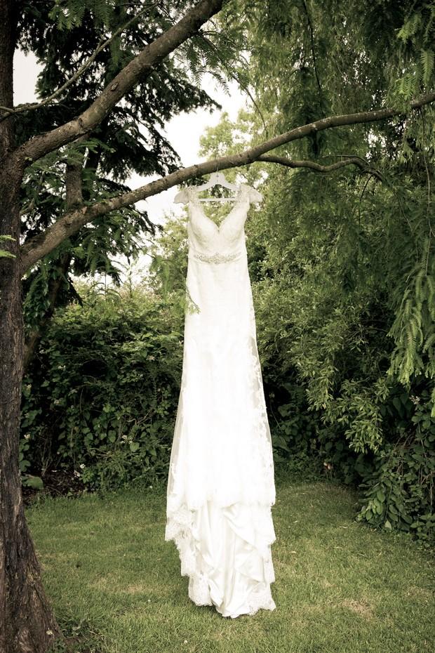 01-wedding-dress-hanging-outdoors-insight-photography-weddingsonline