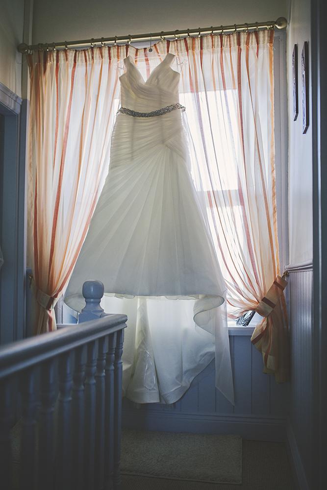 02-Brides-wedding-dress-hanging-weddingsonline