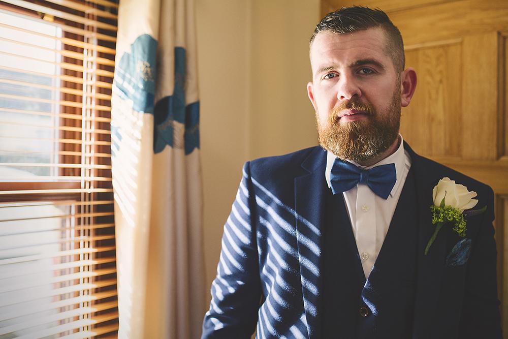 08-Real-groom-navy-wedding-suit-bowtie-weddingsonline