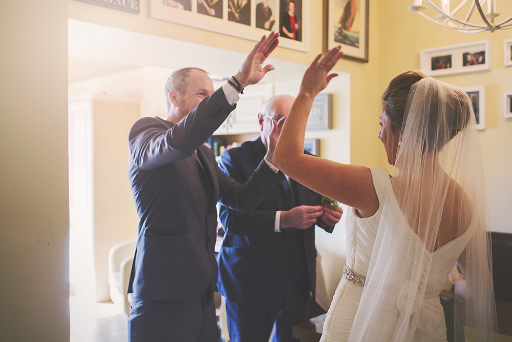 14-Bride-giving-high-five-weddingsonline