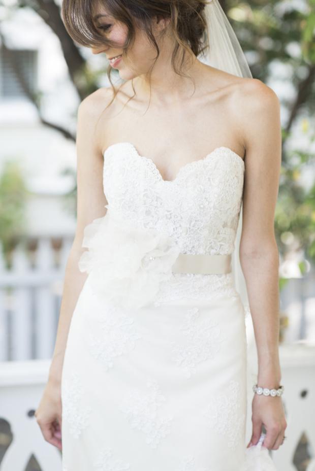 bride-in-wedding-dress-with-floral-corsage-bridal-belt