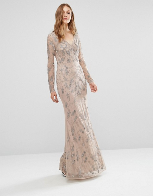 12 stunning sparkly bridesmaid dresses for a winter for Sparkly wedding dresses with sleeves