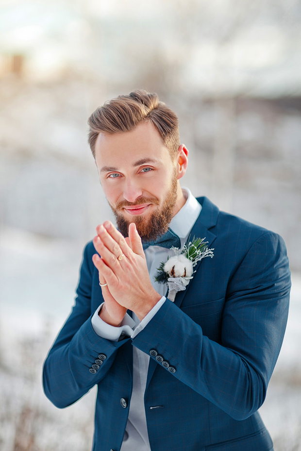groom-in-blue-suit-with-cotton-button-hole