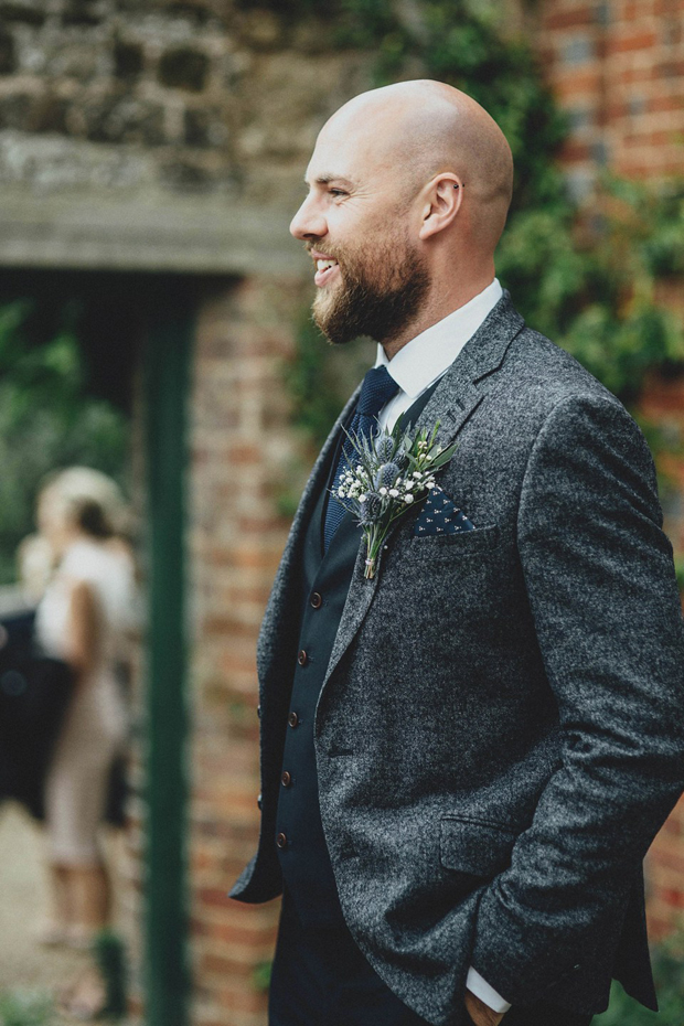 groom-in-grey-wool-jacket-with-navy-waitscoat-and-navy-wool-tie