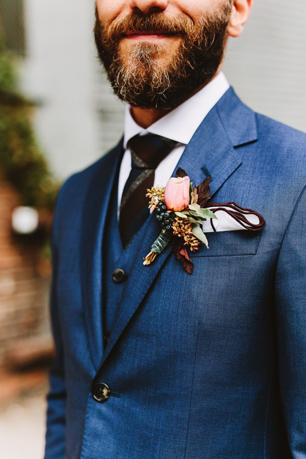 groom-in-navy-suit-with-burgundy-and-teal-stipe-tie-autumn-winter-groom-style