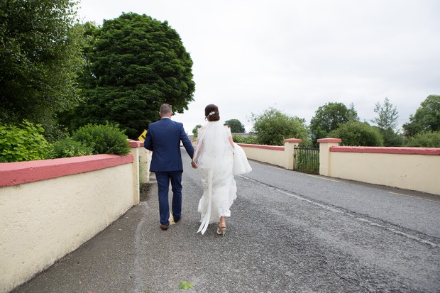 hamlet-court-hotel-real-wedding-bride-and-groom-walking-down-road