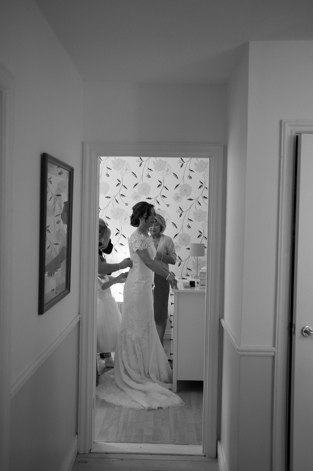 hamlet-court-hotel-real-wedding-bride-getting-in-to-dress