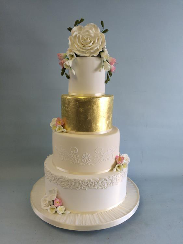 romantic-four-tier-white-wedding-cake-with-gold-foil-layer-by-amazing-cakes