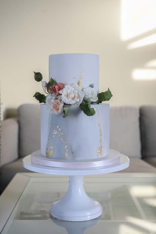two-tier-ivory-wedding-cake-with-gold-leaf-cupcakes-and-counting