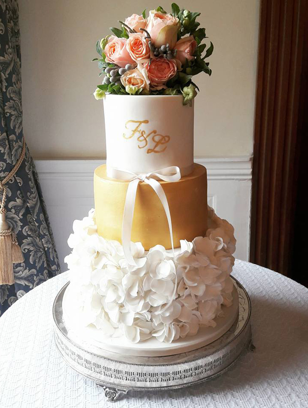 white-and-gold-ruffle-wedding-cake-with-gold-monogram-victoria-cupcakes