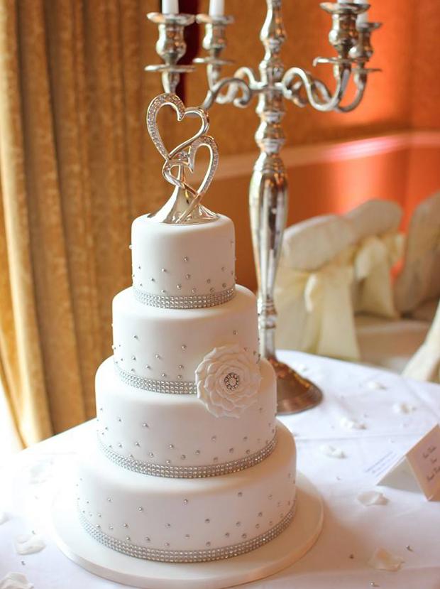 white-four-tier-wedding-cake-with-diamnate-details