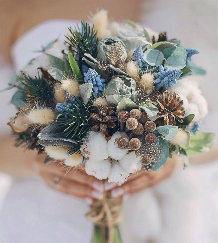 Winter-Wedding-Bouquet-Blue-Thistle-Pinecone-weddingsonline