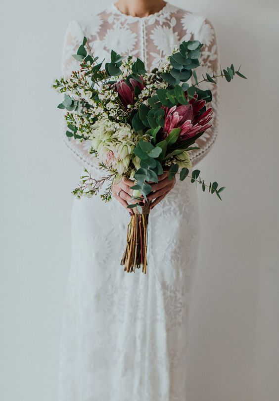 Winter-Wedding-Bouquets-Tall-Greenery-Purple-weddingsonline