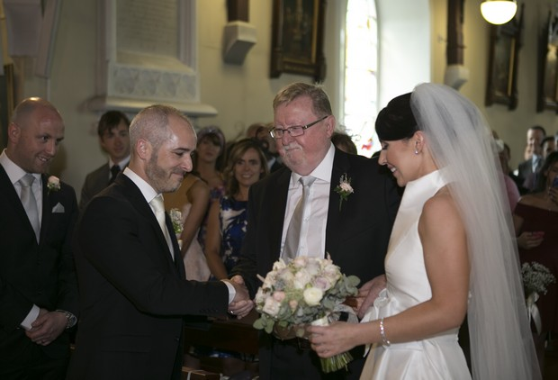 bride-and-dad-with-groom-at-altar