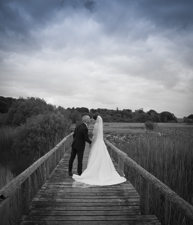 bride-and-groom-kissing-glasson-hotel-bridge