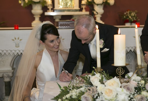 bride-and-groom-signing-register