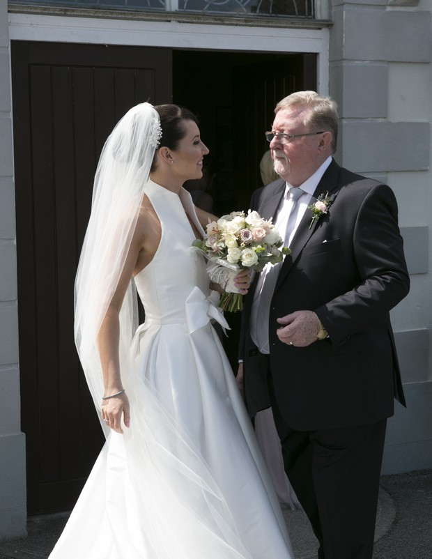 bride-with-father-outside-church