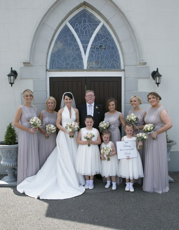bride-withdad-and-bridal-party-outside-chruch