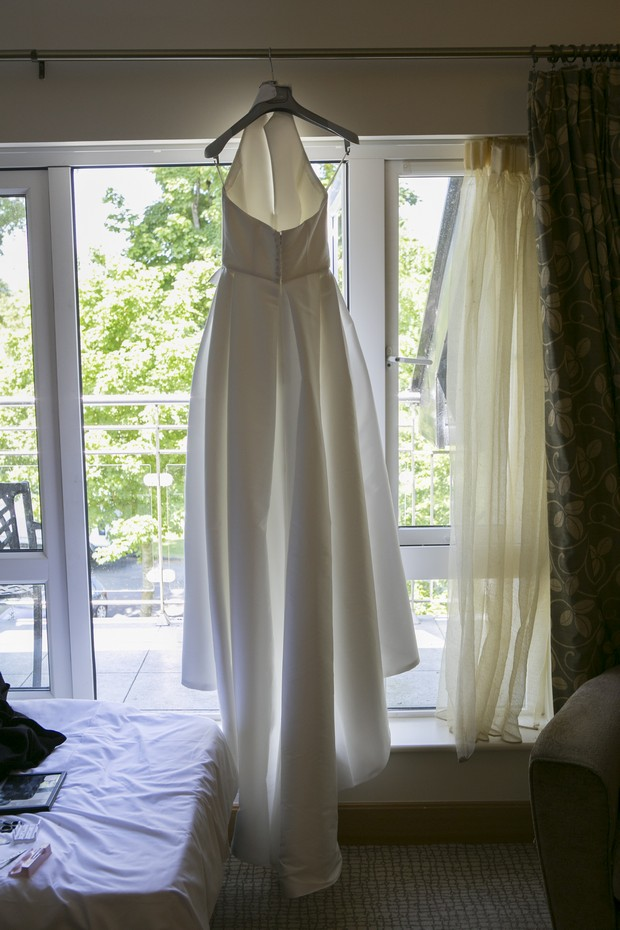 wedding-dress-hanging-from-window