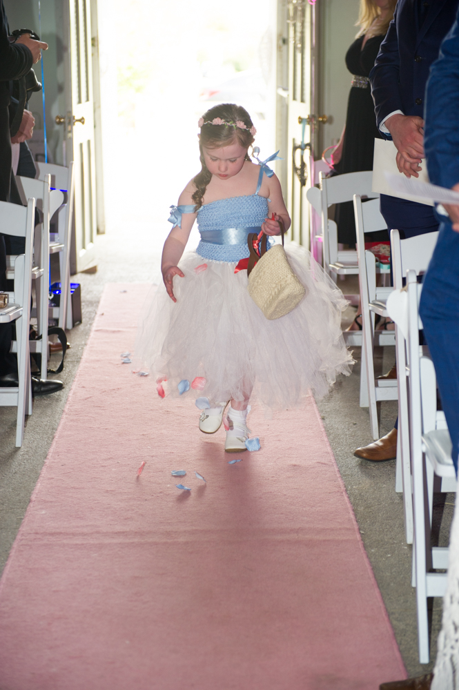 12-flower-girl-aisle-petals-real-wedding-The-Fennells-weddingsonline