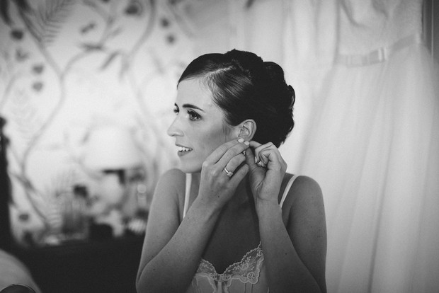 15-Bride-getting-ready-earrings-Emma-Russell-Photography-weddingsonline