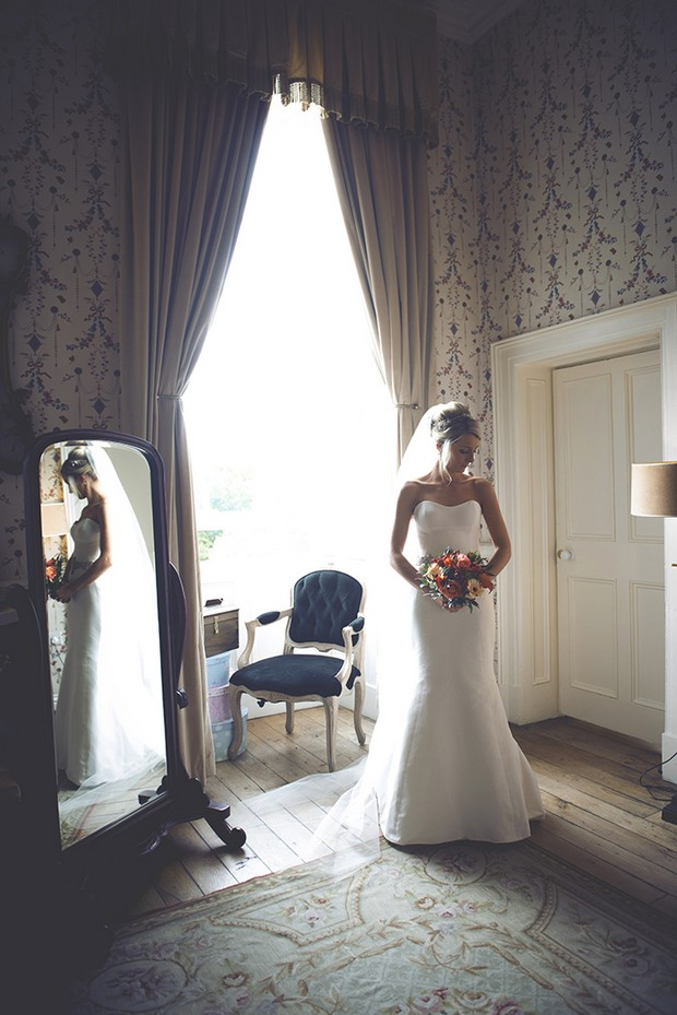 15-Romantic-bridal-portrait-suite-window-Couple-Photography-weddingsonline