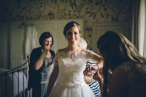 16-Bride-getting-ready-wedding-dress-Emma-Russell-Photography-weddingsonline