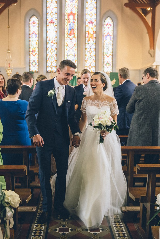 22-Bride-groom-walking-aisle-church-Emma-Russell-Photography-weddingsonline
