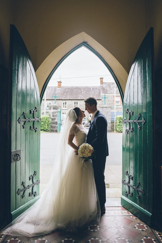 22-Bride-groom-wedding-photography-church-door-Emma-Russell-Photography-weddingsonline