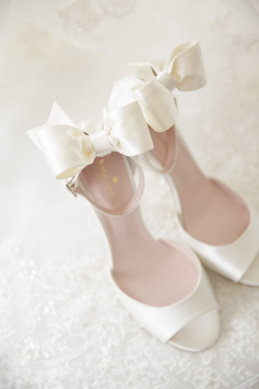 18 of the most wanted wedding shoes for 2018 brides weddingsonline kate spade izzie bow back sandals buy them here junglespirit Gallery