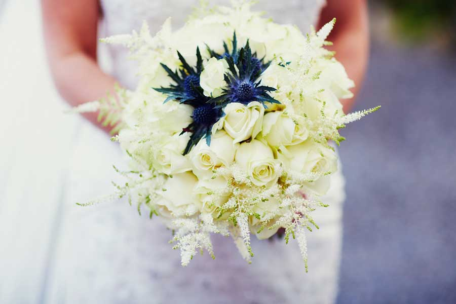 blue white wedding bouquet thistle