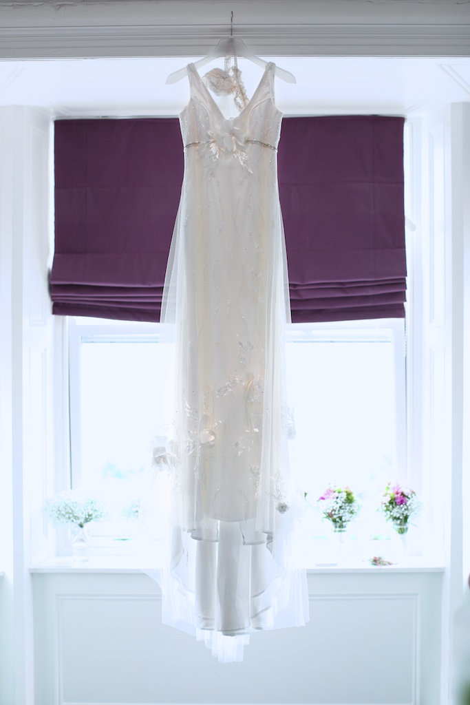 hanging wedding dress purple