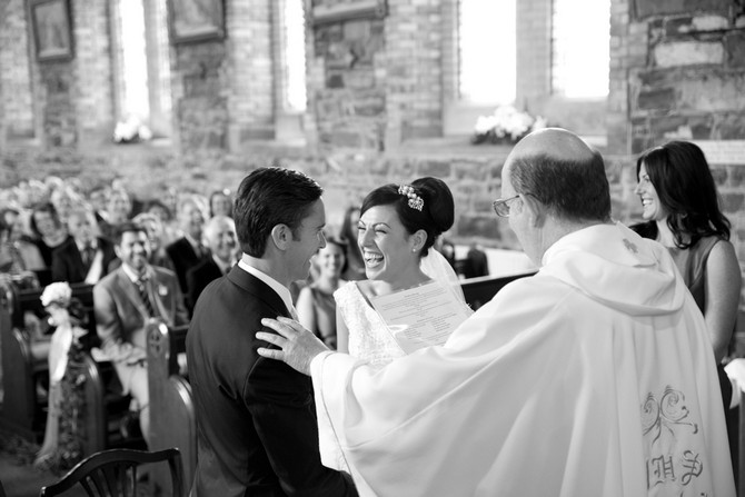 bride laughing wedding ceremony vows