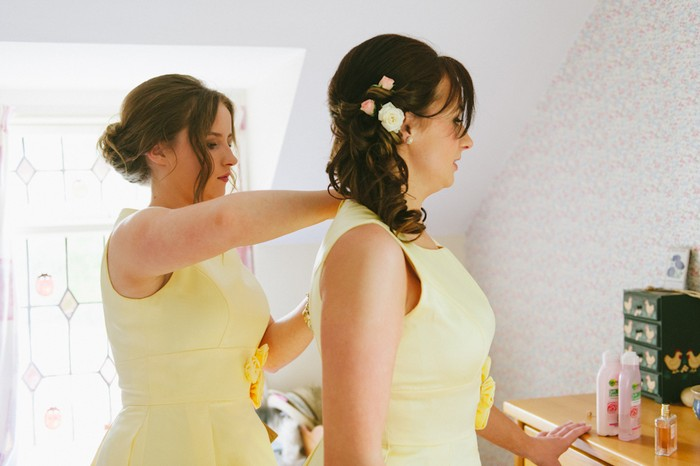 bridesmaids getting dressed