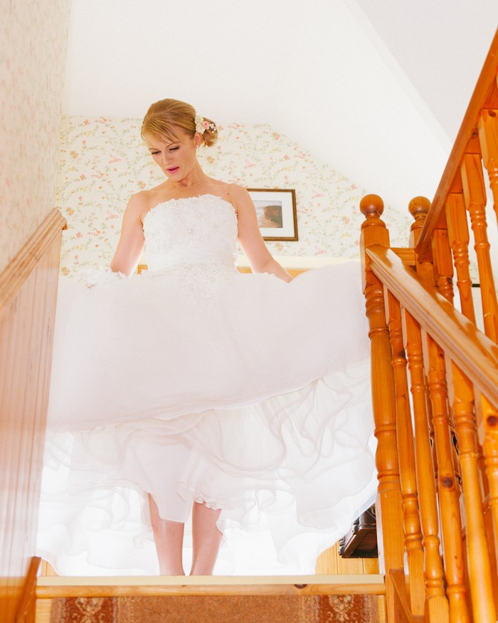 bride walking down stairs 50 style dress