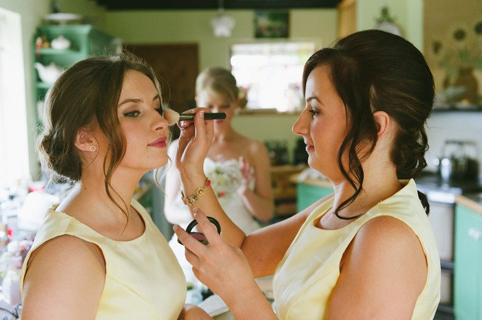 bridesmaids doing each other's make-up