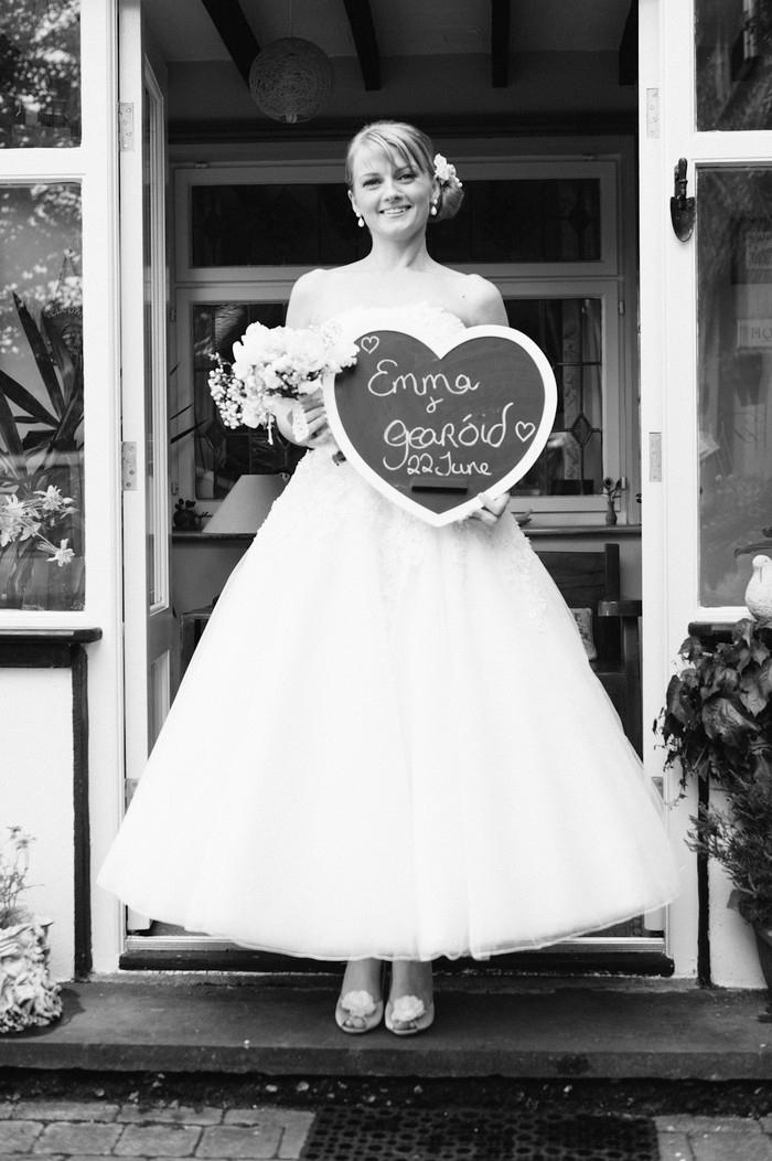 bride with wedding sign heart shaped chalk board