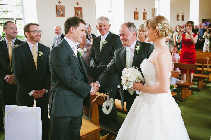 father of the bride giving daughter away wedding ceremony