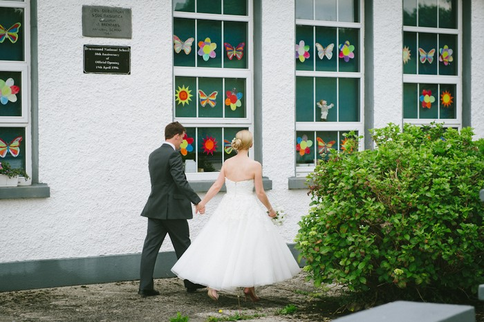 bride and groom outside school wedding by rory o'toole